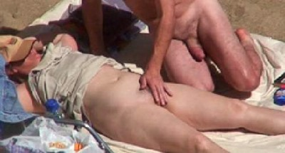 hot-milf-fingered-on-the-beach